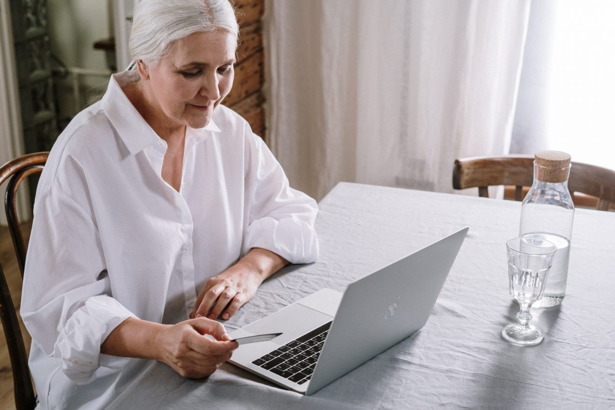 Aged person looking at a laptop